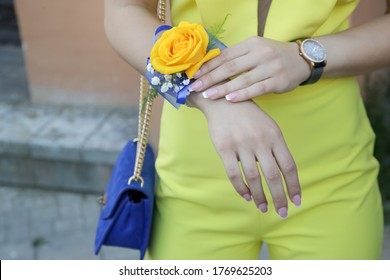 Prom corsage. Close up image of wedding guest wrist with decorative flower. Classic yellow rose corsage.