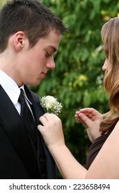Prom Girl Fixing Date's Flower 1