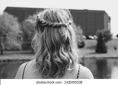 Prom hairstyle looking over lake dramatic black and white