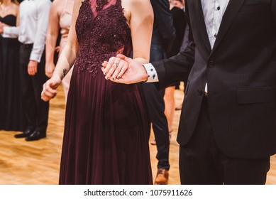 Prom night. Proud young people dancing on a celebration party.
