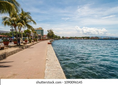 The promenade along Rizal Boulevard with trees and sea view, City of Dumaguete, Negros Oriental, Philippines