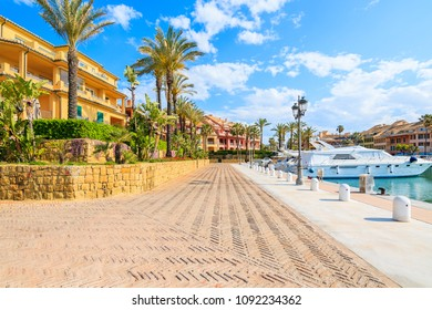 Promenade with beautiful colorful houses in Sotogrande marina, Andalusia, Spain
