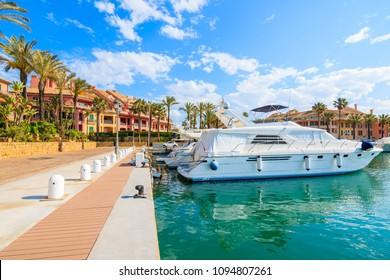 Promenade with beautiful colorful houses in Sotogrande marina, Costa del Sol, Spain