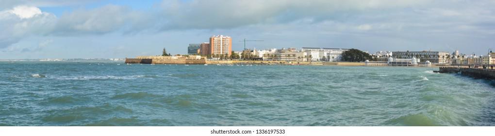 The promenade of Cadiz and Fort Santa Catalina. Panorama of the Spanish city on the Atlantic coast.