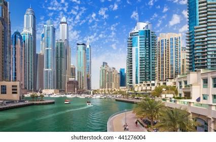 Promenade and canal in Dubai Marina with luxury skyscrapers around,United Arab Emirates