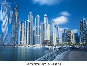 Promenade and canal in Dubai Marina with luxury yachts and skyscrapers,Dubai,United Arab Emirates