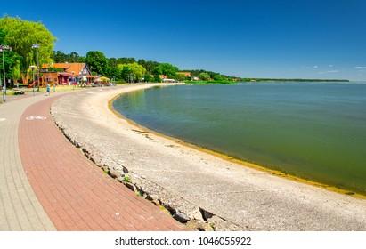 Promenade embankment of small fishing village Nida on the shore of lagoon in National Park Kursiu nerija, the Curonian Spit, Baltic sea, Lithuania