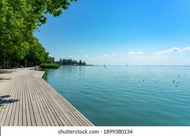 Promenade in Balatonfüred next to lake balaton with wooden lakeside