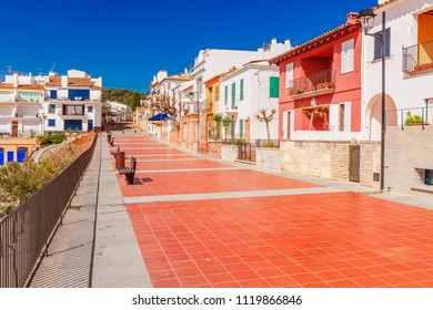 Promenade seafront in Calella de Palafrugell, Catalonia, Spain near Barcelona. Scenic village resort with nice sand beach and clear blue water in nice bay. Famous tourist destination in Costa Brava
