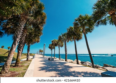 Promenade in South Pointe Park in a sunny day. Miami Beach, Florida.