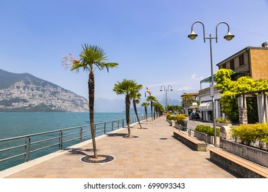 Promenade street in Iseo city on Iseo lake, Lombardy, Italy. Famous Italian resort. Lake Iseo (or Lago d'Iseo) is the 4th largest lake in Lombardy