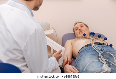 Prominent specialist reading the results of echocardiogram