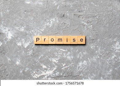 Promise word written on wood block. Promise text on cement table for your desing, concept.
