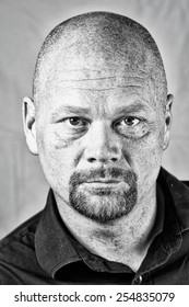 A promotional actor head shot looking into and through the camera.  High structure.
