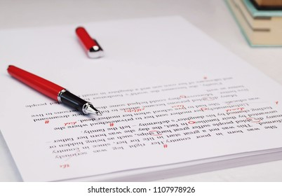 proofreading paper on white table in office