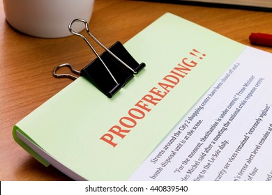 proofreading red word on green sheet on wooden table represent proof read on document