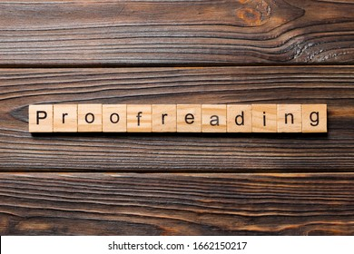 proofreading word written on wood block. proofreading text on table, concept.