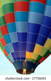 Propane burners being fired in a colorful hot air balloon.