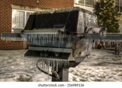 Propane Grill Frozen Over with Ice in Winter