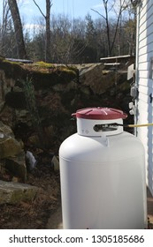 Propane tank with ledge and forest surrounding it