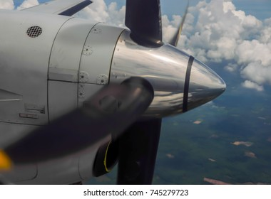 propeller airplane detail flying in tropical paradise background,Thailand.