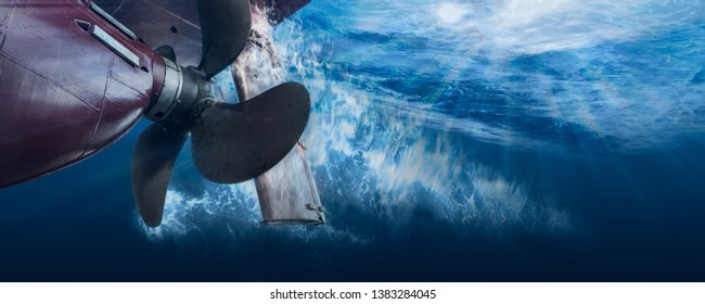 Propeller and rudder of big ship underway from underwater. Close up image detail of ship. Transportation industry. Freight transportation. Ship repair, underwater survey and shipping business concept