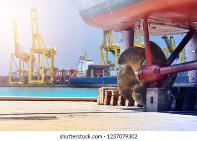 Propeller at stern ship in floating dry dock under Repairing, Maintenance on port logistic background