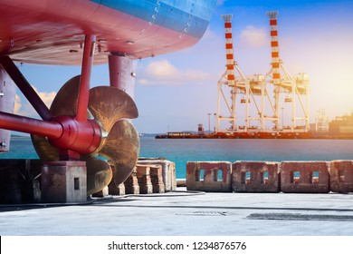 Propeller of vessel repair maintenance at floating dry dock in shipyard  Thailand on crane of port background