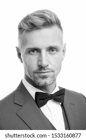 Proper bow tie. Gentleman modern style. Guy well groomed bearded gentleman wear tuxedo. Barber shop concept. Radiating confidence Elegant gentleman. Fashion accessory. Handsome guy close up.