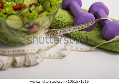 proper nutrition fitness food vegetable salad diet program dumbbells concept of