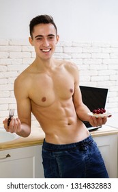 proper nutrition, healthy lifestyle, dieting, metabolism boost. young fit sporty man with muscle body eating tasty dessert