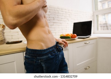proper nutrition, motivation, fitness, healthy lifestyle, diet. fit sporty man with perfect muscle body at home kitchen