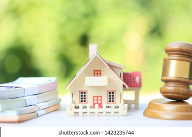 Property auction, Gavel wooden and model house on natural green background, lawyer of home real estate and ownership property concept