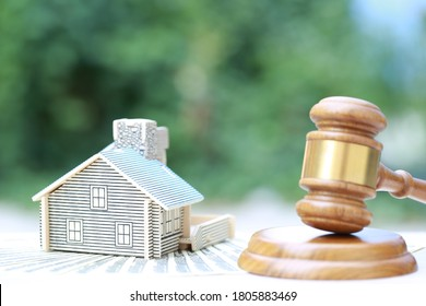 Property auction, Model house and Gavel wooden on natural green background, lawyer of home real estate and ownership property concept