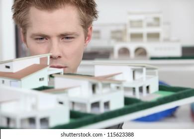 Property developer inspecting model