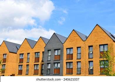 Property development concept with newly built houses against blue sky