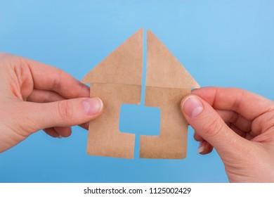 property division concept. scissors cut paper house