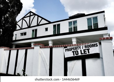 Property, house or room for rent or to let banner outside a double storey house. Rentals from property investment can form a financial portfolio where investors can earn passive or recurring income.