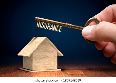 Property insurance concept with key. Key to open new insurance of property (family house).