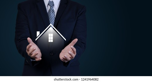 Property insurance and security concept. Real estate agent business hold symbol of house.with free copyspace.