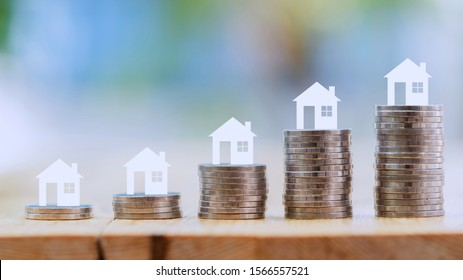 Property investment financial concept. Money stack coin background.