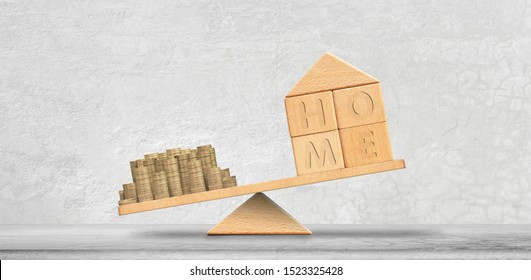 Property investment and mortgage financial concept. Money and home on Scales of justice,loan,mortgage. Change home into cash concept Balance home and debt. Model house and money coins stack balancing