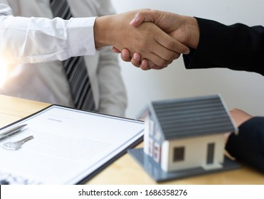 The property manager Shake hands with congratulations on the customers who bought the house with insurance, Hand shake, Success and congratulations concept.