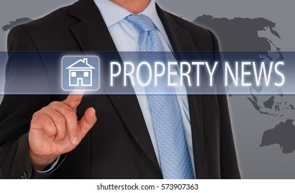 Property News - Real Estate - Businessman with touchscreen
