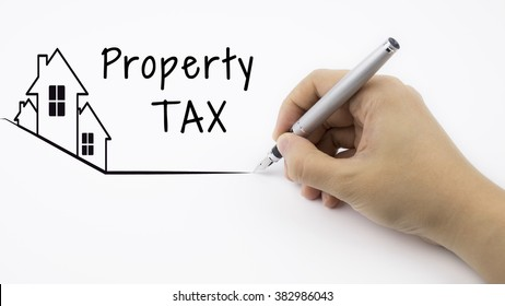 Property TAX - Real Estate concept with female hand and pen