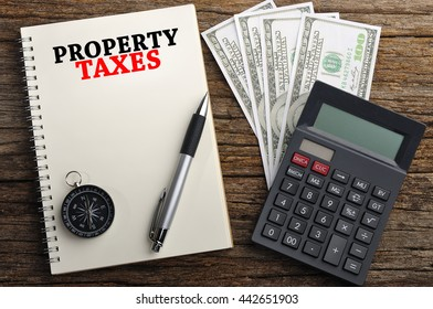 """""""PROPERTY TAXES"""" Word On Note Book, Finance Concept"""