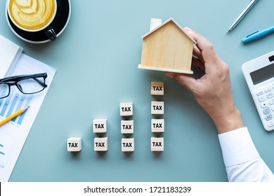 Property tax.investment planning.business real estate.economy crisis.expenses of worker.rent or buy house.top view
