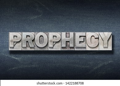 prophecy word made from metallic letterpress on dark jeans background