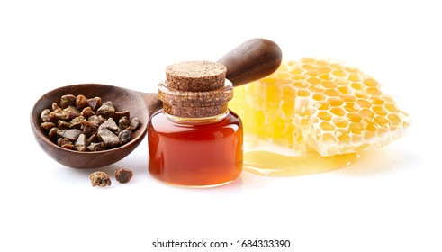 Propolis granule with honeycomb and  propolis tincture on white background