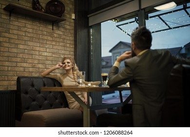 Proposal and anniversary. Business meeting of man and woman. Date of family couple in romantic relations, love. Couple in love at the restaurant. Valentines day with sexy woman and bearded man.